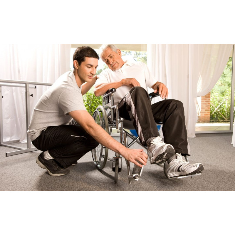 Man in wheel chair being aligned
